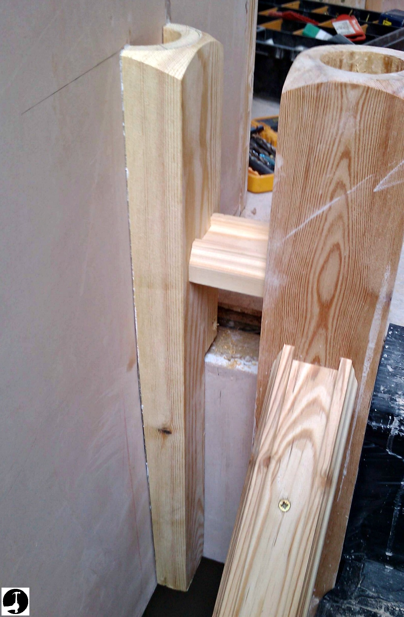 Half newel base cut and glued to the wall