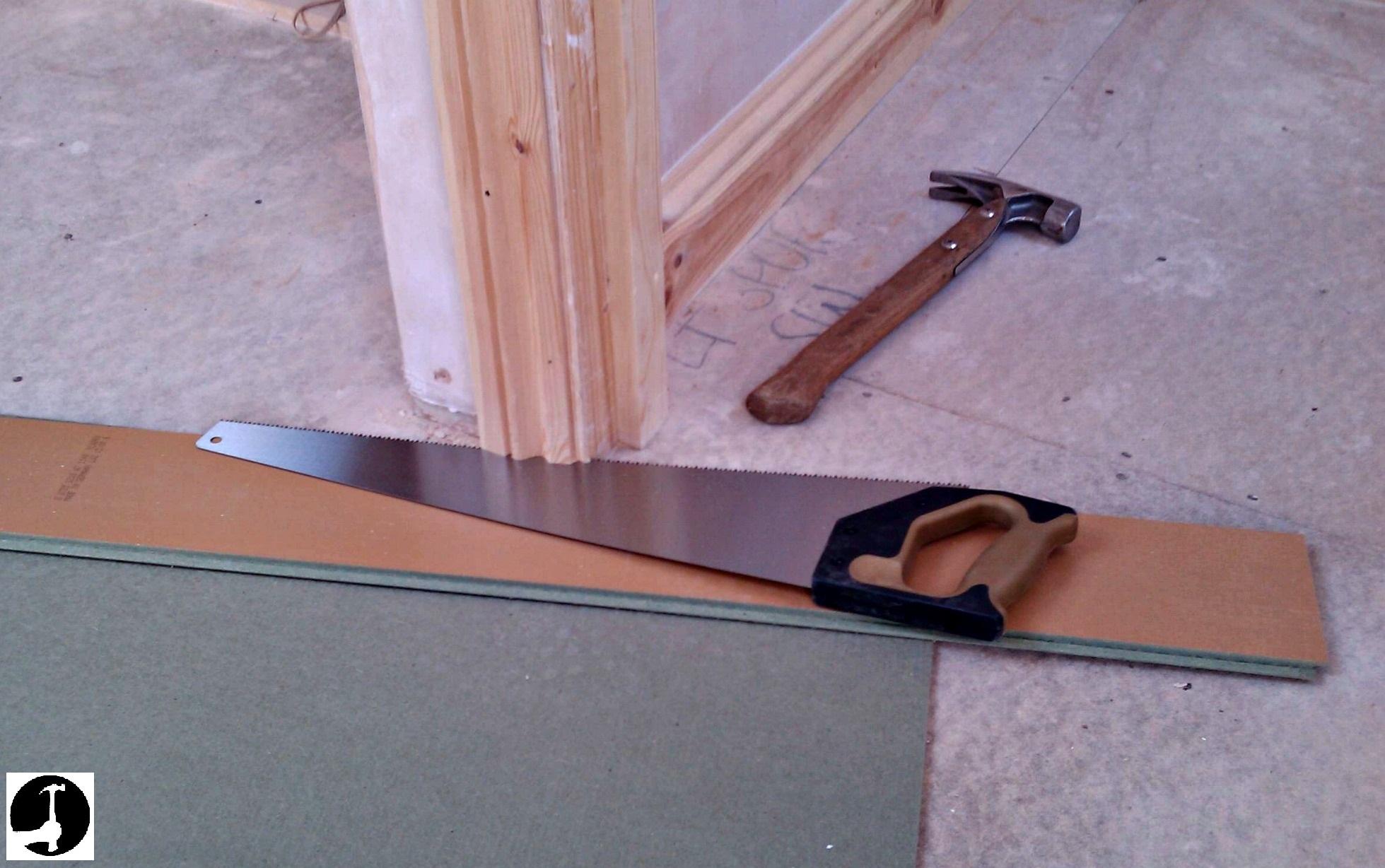 Cut the bottom of the door jamb off