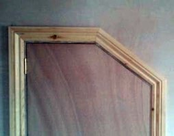 Angled door architrave