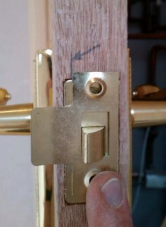 How to fit the door latch strike plate