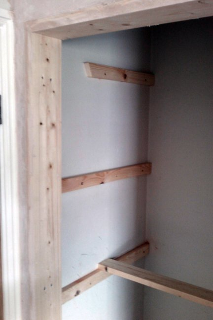Slatted shelves and airing cupboard shelf for A bathroom item that starts with n