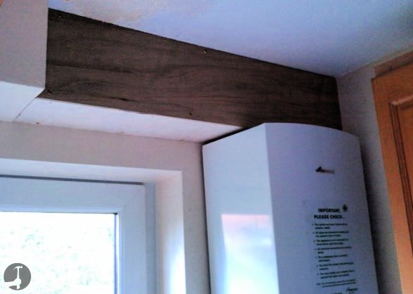 Piper boxing bulkhead above a boiler to hide unsightly pipework