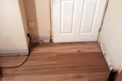 Laying laminate in a doorway for Hardwood floors expansion gap