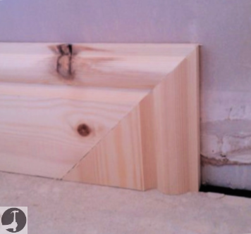 End skirting board by mitering down to the floor